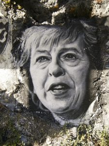 This image shows a strained looking Theresa May after the election.